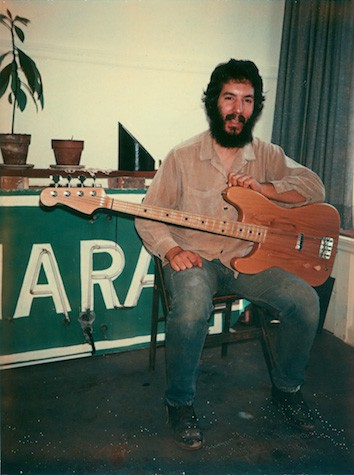 Megas-with-his-first-instrument-a-left-handed-bass-San-Francisco-1975